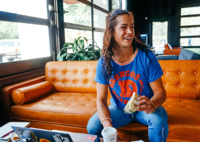 customer smiling on couch in coffee shop